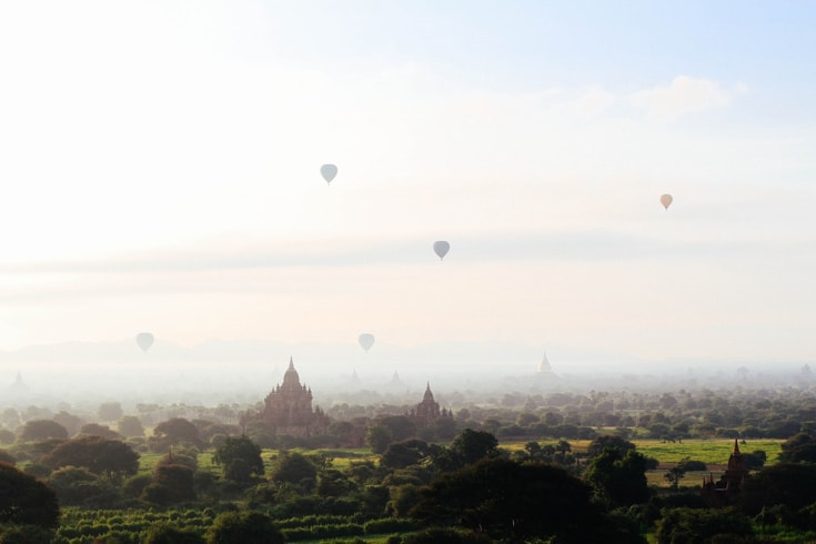 Landscape filled with stupas, sky filled with hot air balloons