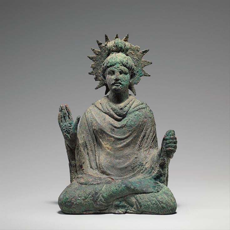 A statue of a person meditating.