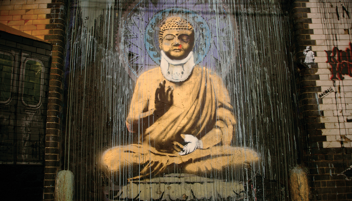 A photo of a painting of Buddha with a neck brace. It is street art.