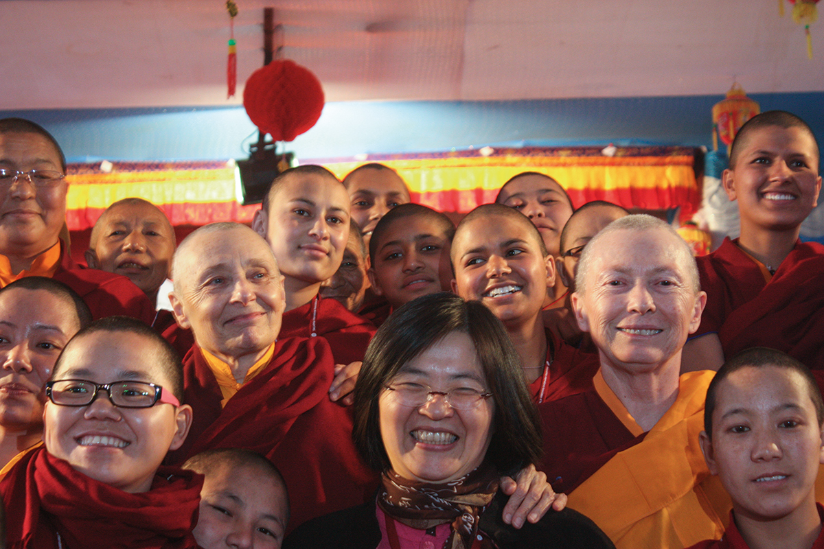 A photo of a group of women. All are wearing red.