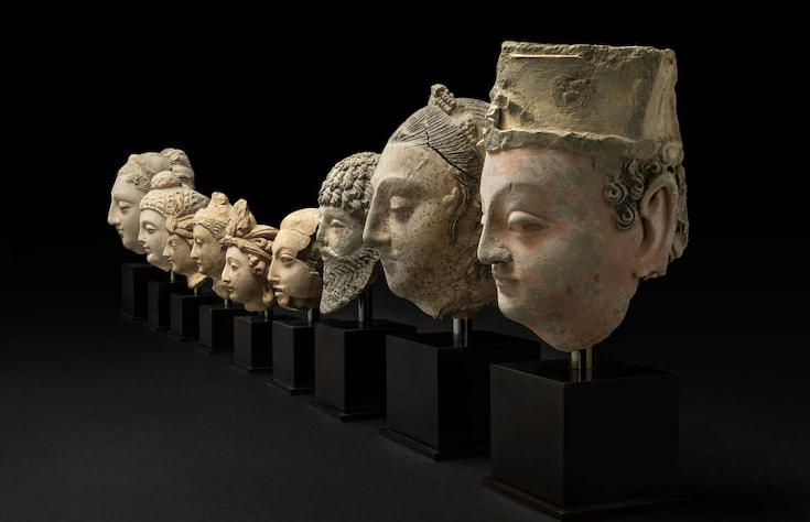 Row of heads from Buddhist sculptures