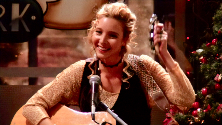 Phoebe Buffay from friends playing guitar