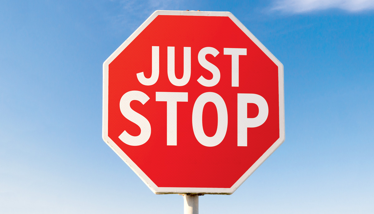 """A stop sign that reads """"Just stop."""""""