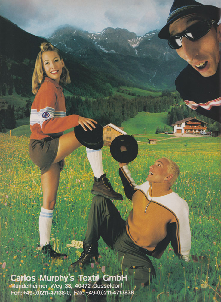 An ad. There are three people in hoodies and shorts, with mountains in the background.