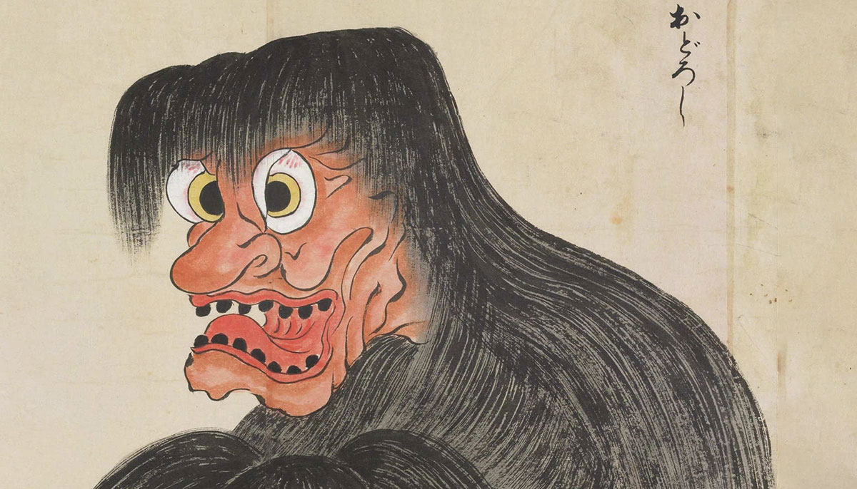 A drawing of a monster with long black hair covering its body
