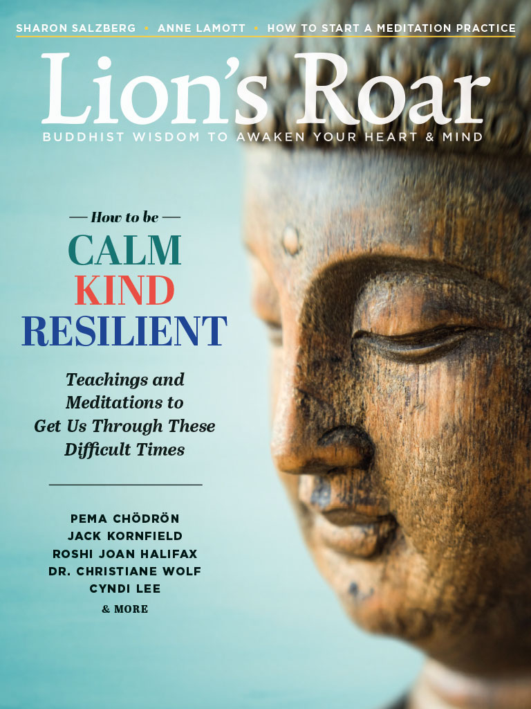 Cover of July 2020 magazine. There is a wooden Buddhist statue looking sideways against a blue background.
