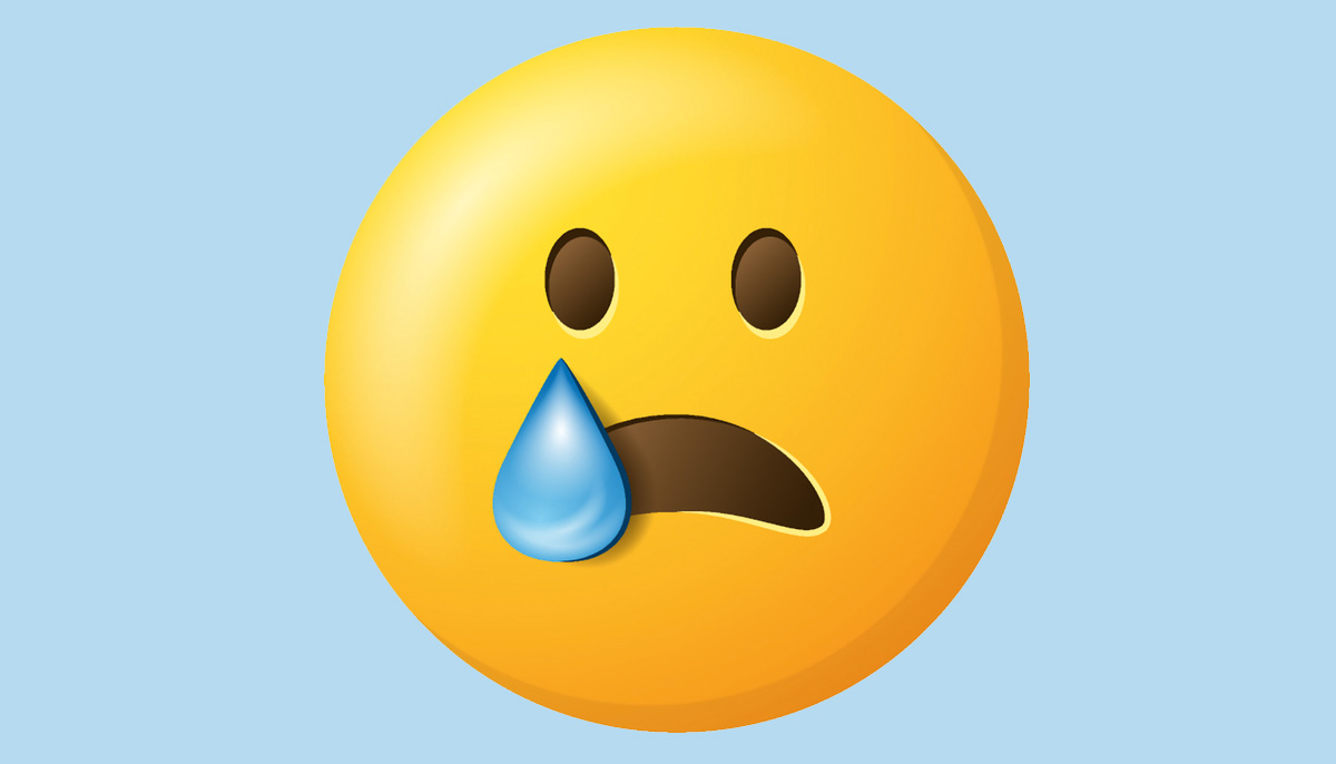 An emoji face of someone with one tear.