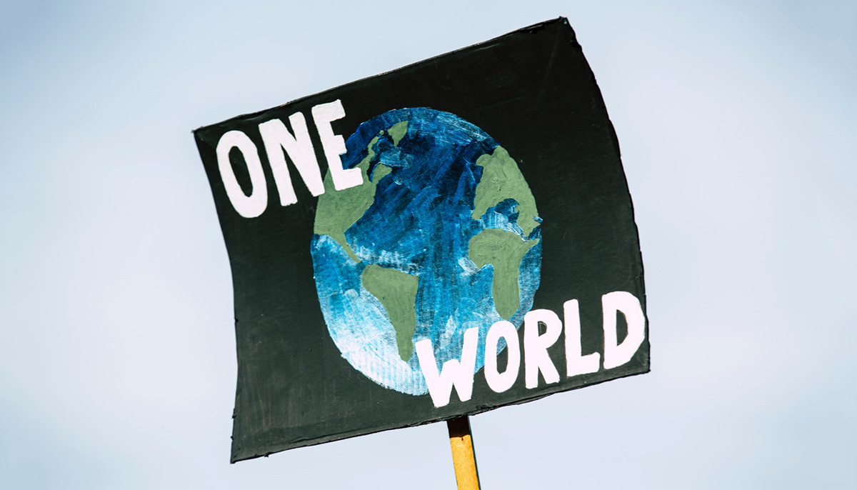 """image of poster with """"One World"""" and Earth painted"""