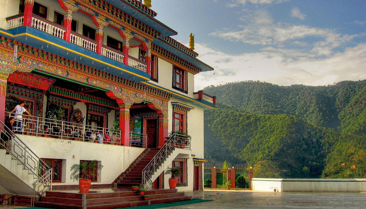 Photo of Druk Gawa Khilwa nunnery with mountains in background