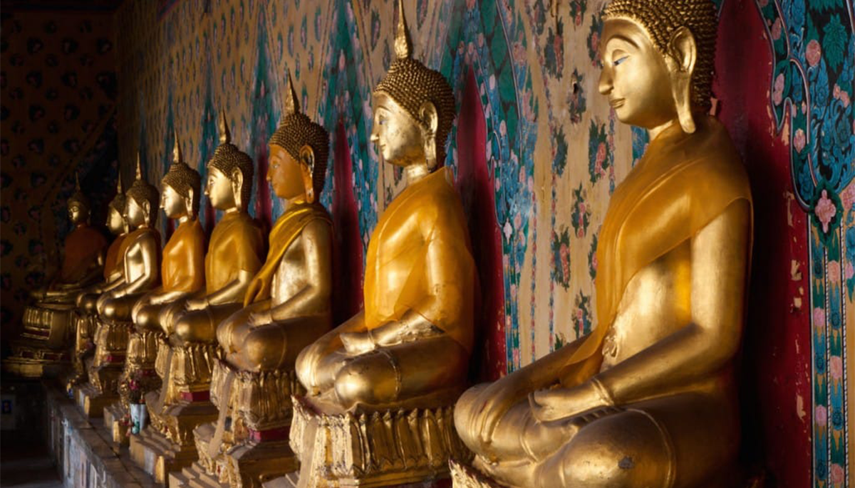 Gold statues all lined up in a row.