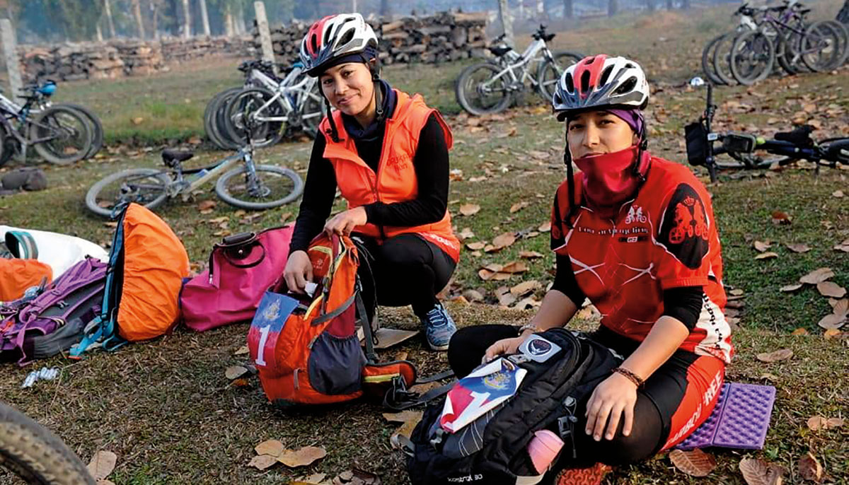 Two nuns in cycling gear packing their bags