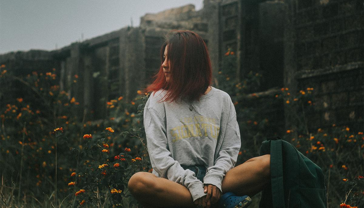 Woman meditation in flowers.