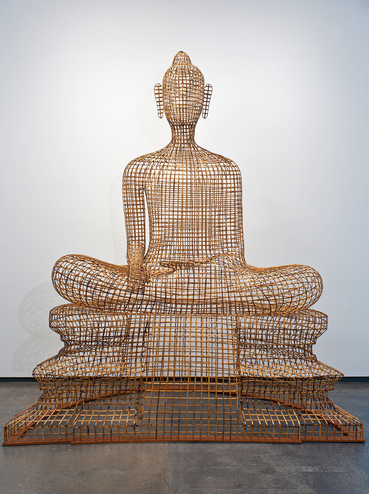 Buddha statue made out of wires.