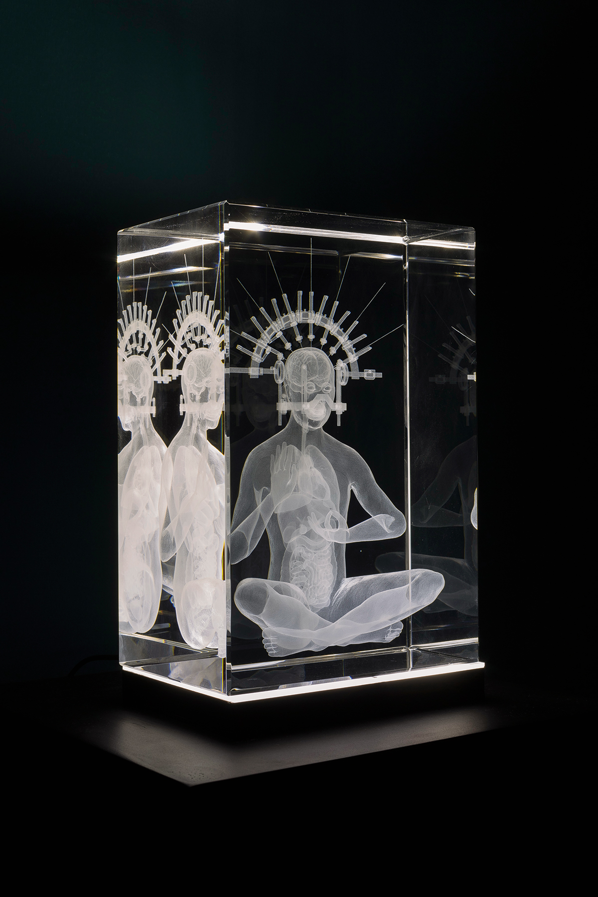 A person in a glass cube.