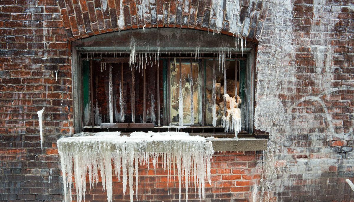 A frozen brick wall.